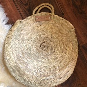 Woven straw circle tote